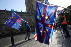 Anti-Brexit demonstrators hold flags opposite the Houses of Parliament in London, Britain, December 11, 2018. REUTERS/Simon Dawson
