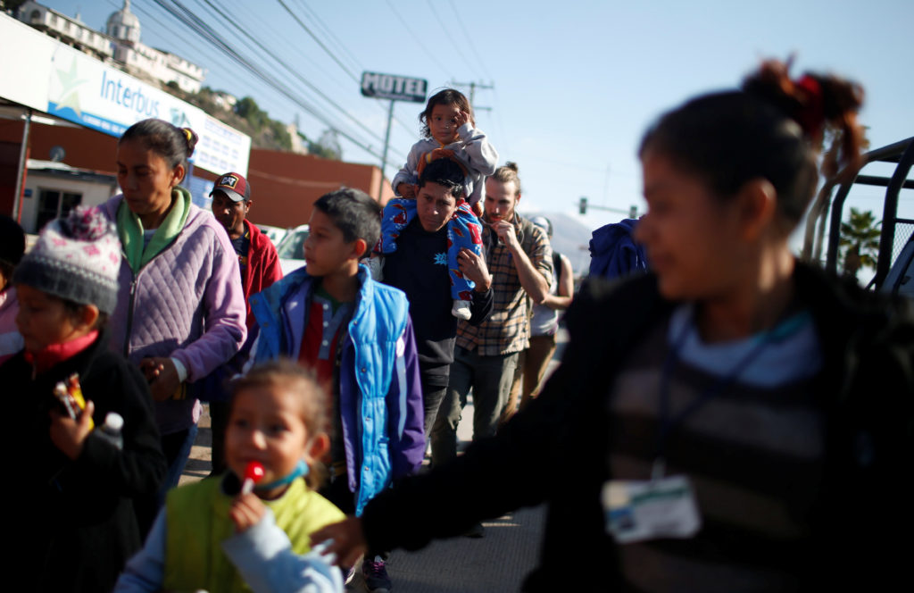 Migrants, part of a caravan of thousands from Central America trying to reach the United States, march demanding for more ...