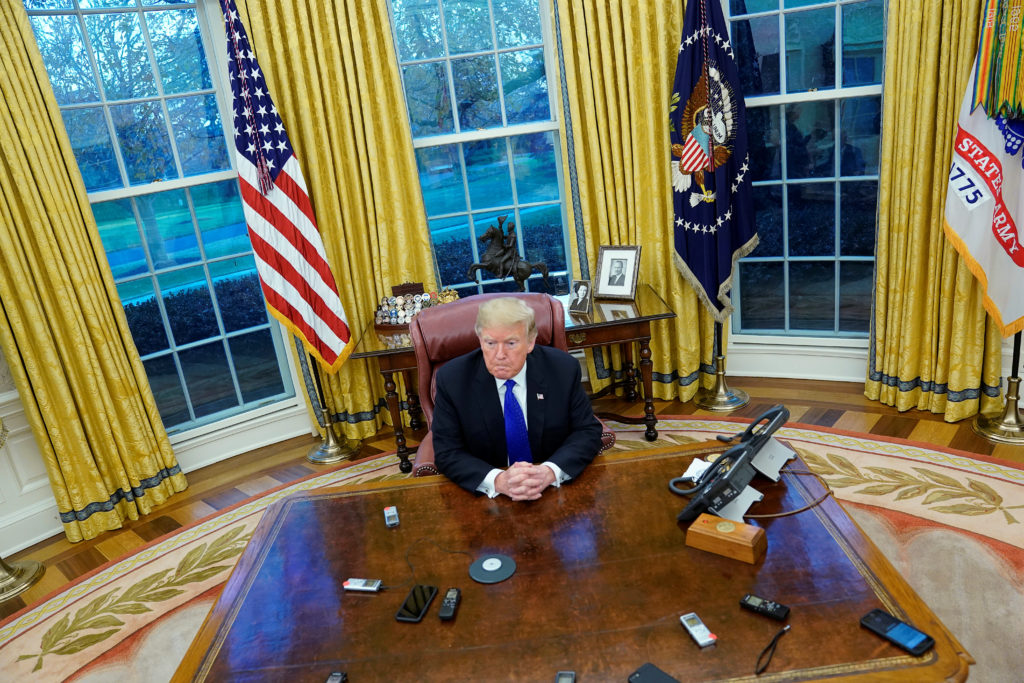 President Donald Trump answers questions in the Oval Office. Guidance from the Department of Justice's Office of Legal Counsel says a sitting president cannot be indicted. Photo by Jonathan Ernst/Reuters