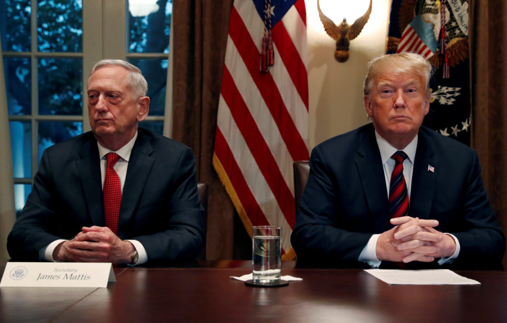 U.S. President Donald Trump speaks to the news media while gathering for a briefing from his senior military leaders, including Defense Secretary James Mattis (L), in the Cabinet Room at the White House in Washington, U.S., October 23, 2018. Photo by Leah Millis/Reuters