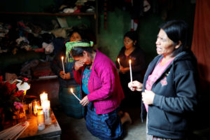 Catarina Perez (center), grandmother of Felipe Gomez Alonzo, a 8-year-old boy detained alongside his father for illegally entering the U.S., who fell ill and died in the custody of U.S. Customs and Border Protection, reacts while praying at an altar in memory of Felipe at the family's home in the village of Yalambojoch, Guatemala, on December 27, 2018. Luis Echeverria/Reuters