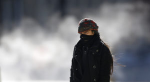 A woman is bundled up against the cold weather in downtown Chicago, Illinois. Photo by Jim Young/Reuters