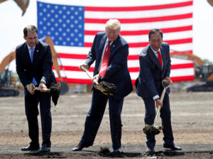 U.S. President Donald Trump takes part in a groundbreaking with Wisconsin Governor Scott Walker (L) and Foxconn Chairman Terry Gou (R) during a visit to Foxconn's new site in Mount Pleasant, Wisconsin, U.S., June 28, 2018. REUTERS/Kevin Lamarque