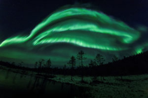Northern lights seen over Rovaniemi in Lapland, Finland, in 2018. Researchers discovered the northern and southern lights are not symmetrical, and now they think they know why. Image by REUTERS/Alexander Kuznetsov