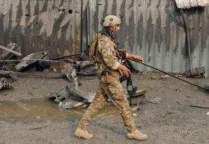 A member of Afghan security force walks at the site of a car bomb attack in Kabul, Afghanistan. Photo by Mohammad Ismail/Reuters