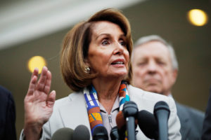 House Democratic leader Nancy Pelosi (D-Calif.) speaks to reporters as Senator Dick Durbin (D-Ill.) looks on following a border security briefing with President Donald Trump and congressional leadership at the White House in Washington, D.C. Photo by Carlos Barria/Reuters