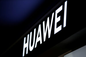 A sign of Huawei is pictured at its shop in Beijing, China. Photo by Jason Lee/Reuters