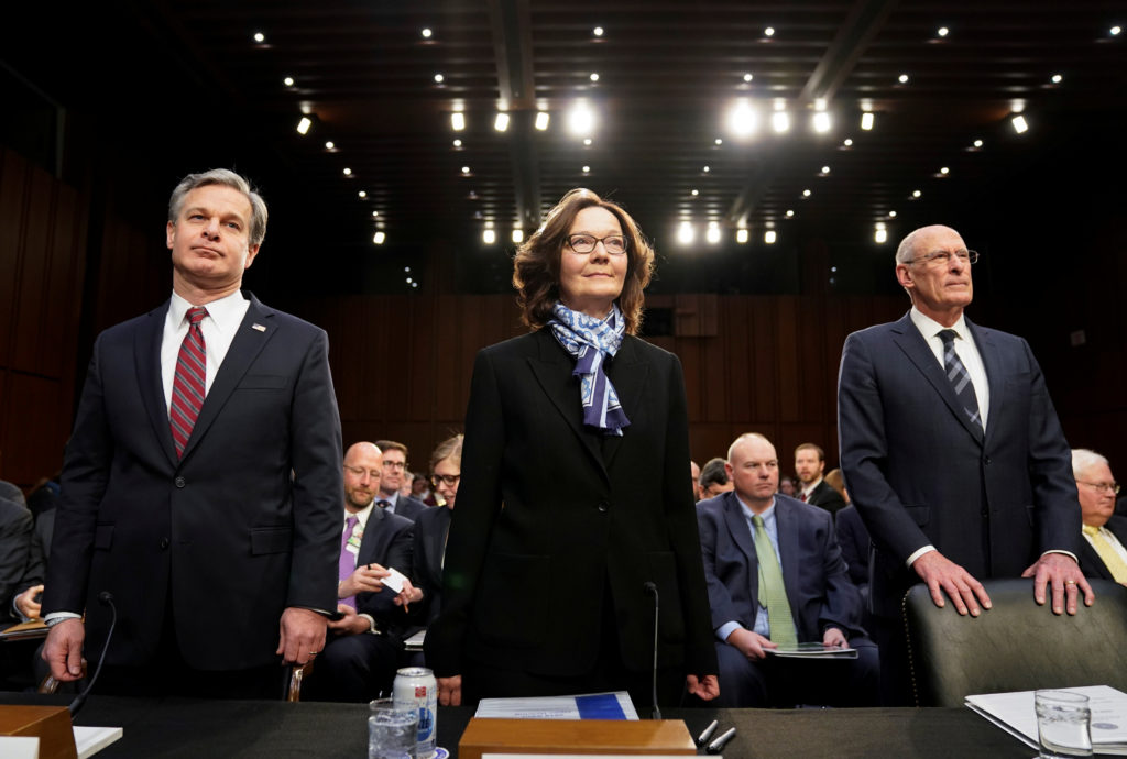 "FBI Director Christopher Wray; CIA Director Gina Haspel and Director of National Intelligence Dan Coats arrive with other U.S. intelligence community officials to testify before a Senate Intelligence Committee hearing on ""worldwide threats"" on Capitol Hill in Washington, U.S., January 29, 2019. REUTERS/Joshua Roberts"