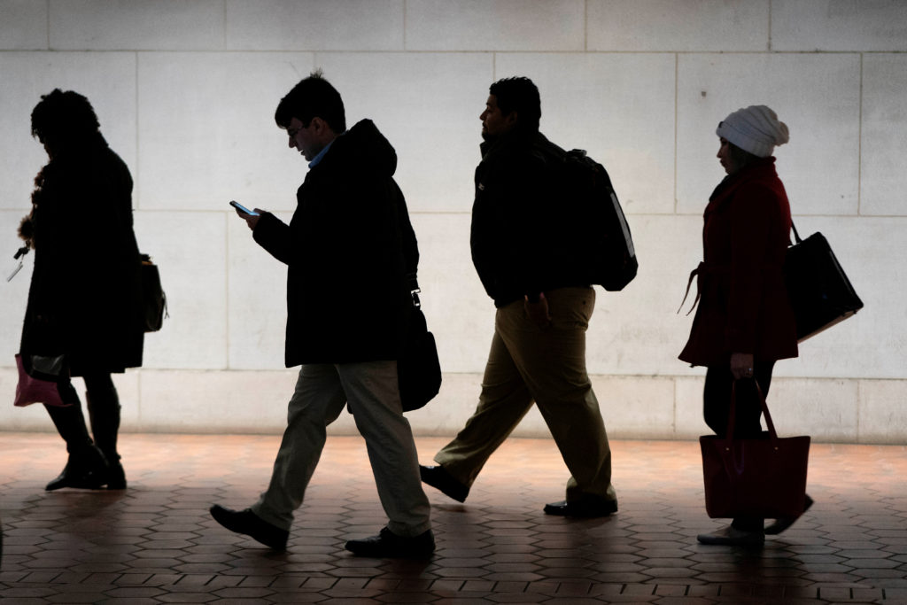 Commuters walk from the Federal Triangle Metro station after the U.…
