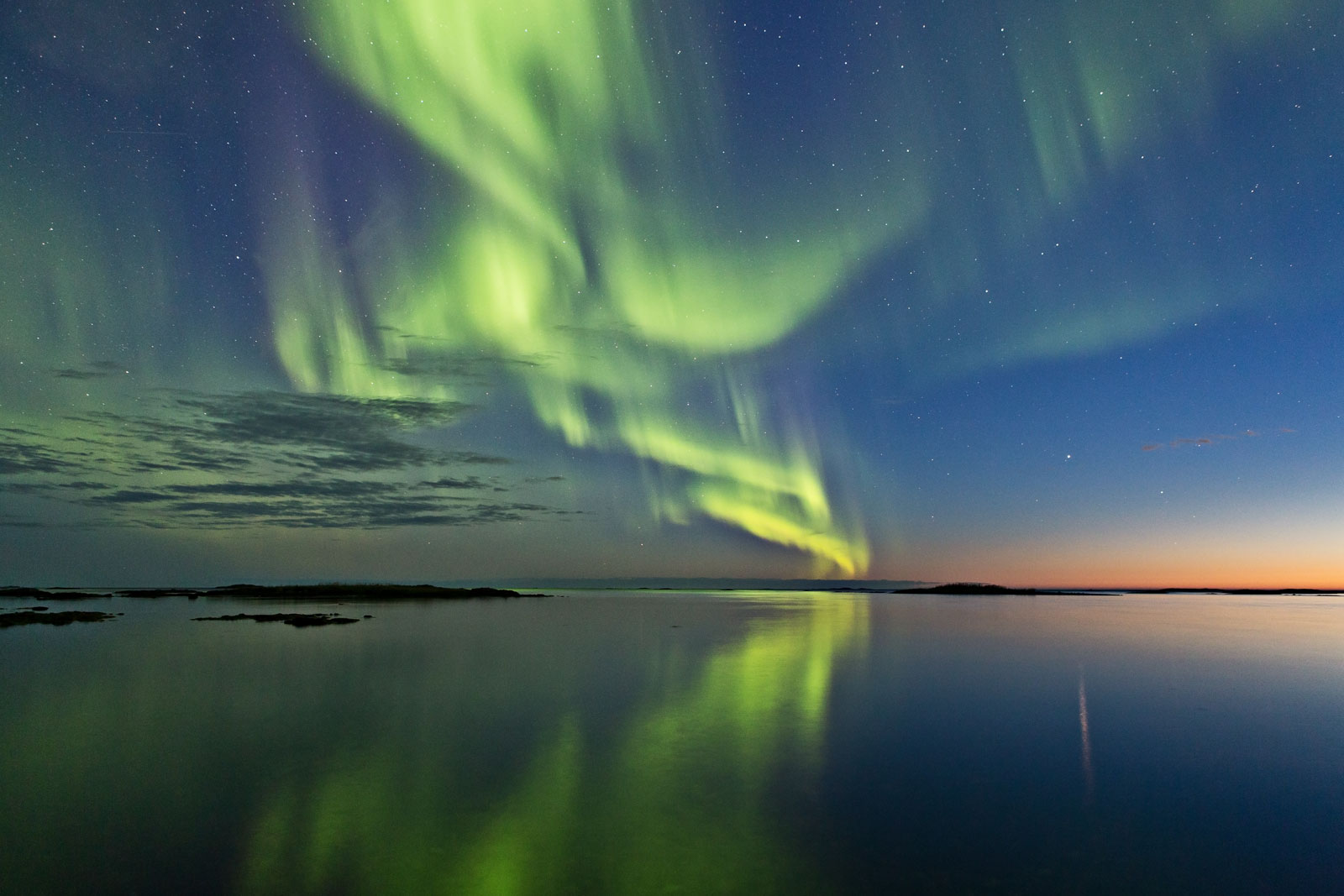 The northern and southern lights appear like drifting ribbons of light, but are actually the result of turmoil in the upper atmosphere. Image by Frank Olsen/Wikimedia