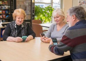 "Medicare beneficiaries at The Callahan Center in Framingham, Massachusetts try out the new ""What's Covered"" app. Photo courtesy: Centers for Medicare and Medicaid Services"