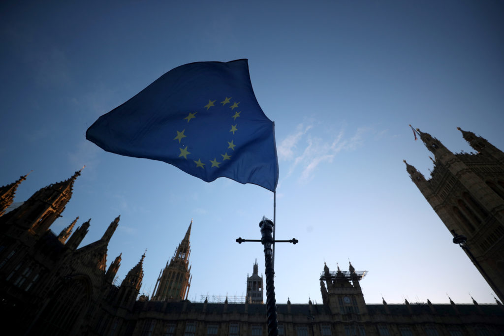 An EU flag flutters during an anti-Brexit demonstration outside the…