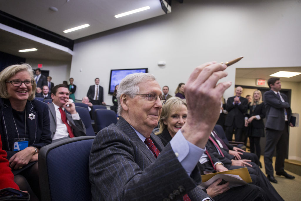 Senate Majority Leader Mitch McConnell, a Republican from Kentucky, holds a hemp pen before the start of a signing ceremony for H.R. 2, Agriculture Improvement Act of 2018, at the White House in Washington, D.C., U.S., on Thursday, Dec. 20, 2018. The Trump administration's aid package for U.S. farmers hurt by the trade war could end up saving some soybean acres next year. Photographer: Zach Gibson/Bloomberg via Getty Images