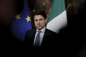 Prime Minister Giuseppe Conte and the Vice Premier looks on during the press conference at the end of the Council of Ministers that approved a decree-law on citizenship income and pensions in Rome, Italy. Photo by Simona Granati/Corbis/Getty Images