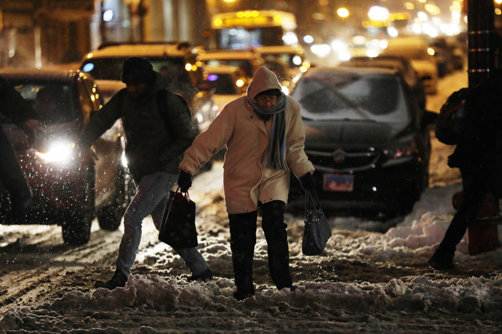 Pedestrians contend with snow and cold weather at Clinton Street and Jackson Boulevard in Chicago. Photo by Terrence Antonio James/Chicago Tribune/TNS via Getty Images