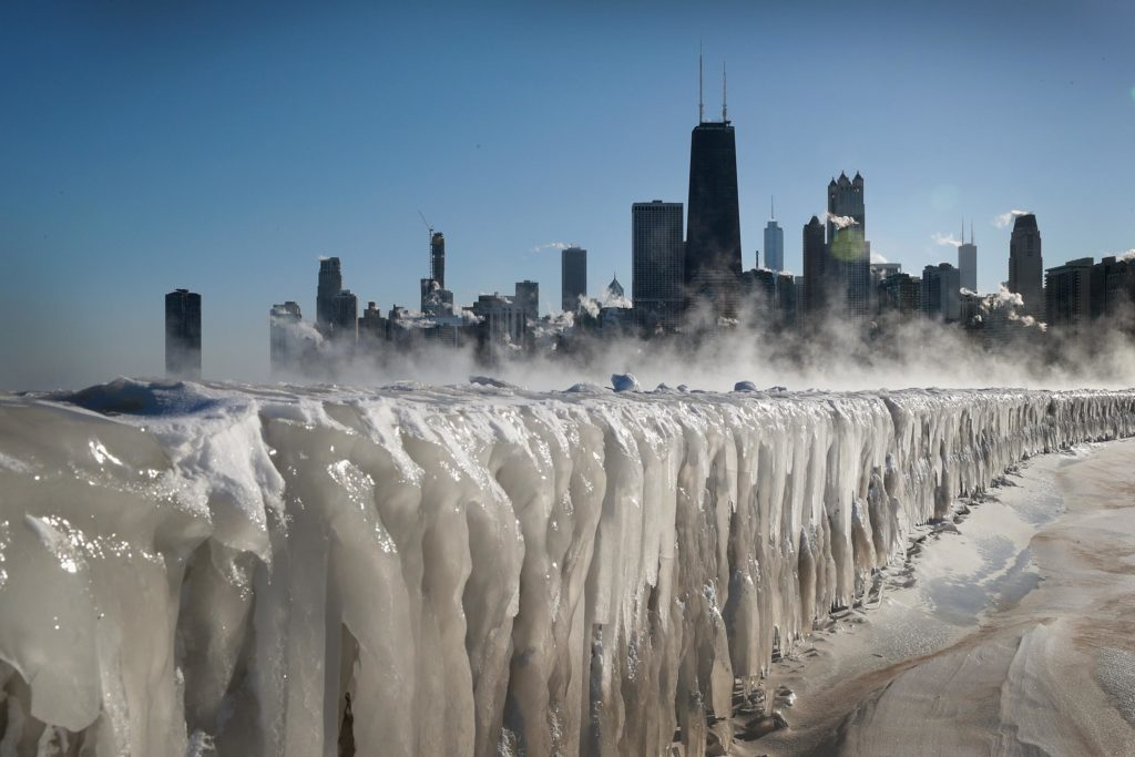 Ice covers the Lake Michigan shoreline on January 30, 2019 in Chicago, Illinois. Businesses and schools have closed, Amtrak has suspended service into the city, more than a thousand flights have been cancelled and mail delivery has been suspended as the city copes with record-setting low temperatures. Photo by Scott Olson/Getty Images