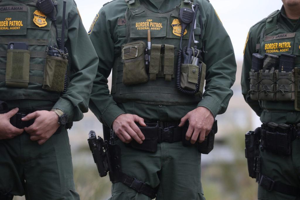 U.S. Customs and Border Patrol agents watch as President Donald Tru…