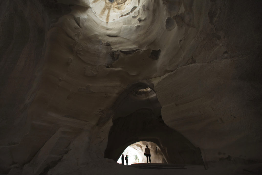 Visitors walk inside a cave situated below the ancient towns of Maresha and Beit Guvrin in the Judean Lowlands June 24, 2014. UNESCO designated the caves of Maresha and Beit Guvrin as a world heritage site. The site features expansive man-made ancient tunnel systems, some dating back as early as the first century BC. REUTERS/Finbarr O'Reilly