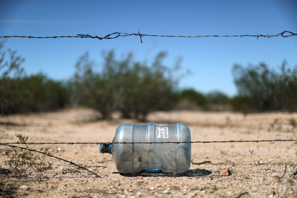 A water bottle likely left by a migrant crossing the desert is seen in Pima County, Arizona. Data suggests a crackdown on immigration at other parts of the border is forcing migrants to take more dangerous paths into the United States. Photo by Lucy Nicholson/Reuters