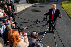President Donald Trump speaks to the media as he departs for Camp David from the White House in Washington, D.C. Photo by Joshua Roberts/Reuters