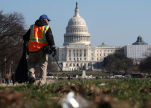 A worker picks up trash on the National Mall near the U.S. Capitol building as the partial government shutdown continues in Washington, D.C. Photo by Jim Young/Reuters