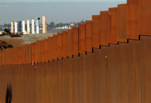 The prototypes for U.S. President Donald Trump's border wall are seen behind the border fence between Mexico and the United States, in Tijuana, Mexico. Photo by Jorge Duenes/Reuters