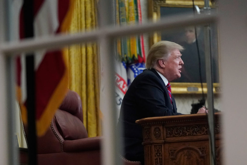 U.S. President Donald Trump delivers a televised address to the nation from his desk in the Oval Office, about immigration...