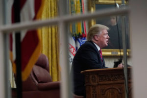 U.S. President Donald Trump delivers a televised address to the nation from his desk in the Oval Office, about immigration and the southern U.S. border on the 18th day of a partial government shutdown, at the White House in Washington, U.S., January 8, 2019. REUTERS/Joshua Roberts - RC1BC78DD490
