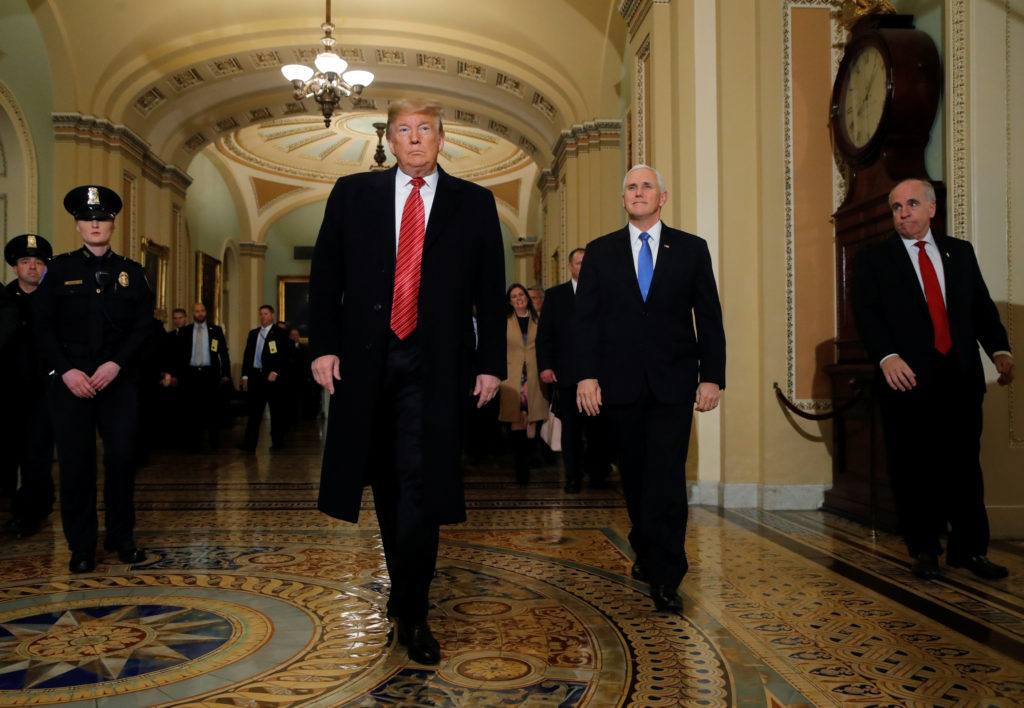 President Donald Trump is accompanied by Vice President Mike Pence as they arrive to attend a closed Senate Republican pol...