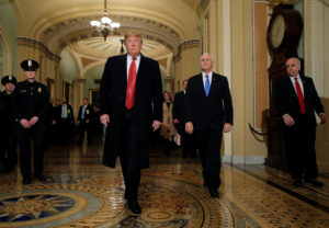 President Donald Trump is accompanied by Vice President Mike Pence as they arrive to attend a closed Senate Republican policy lunch. Trump and Democratic lawmakers have not been able to overcome their differences, pushing the government shutdown into its 20th day. Photo by Jim Young/Reuters