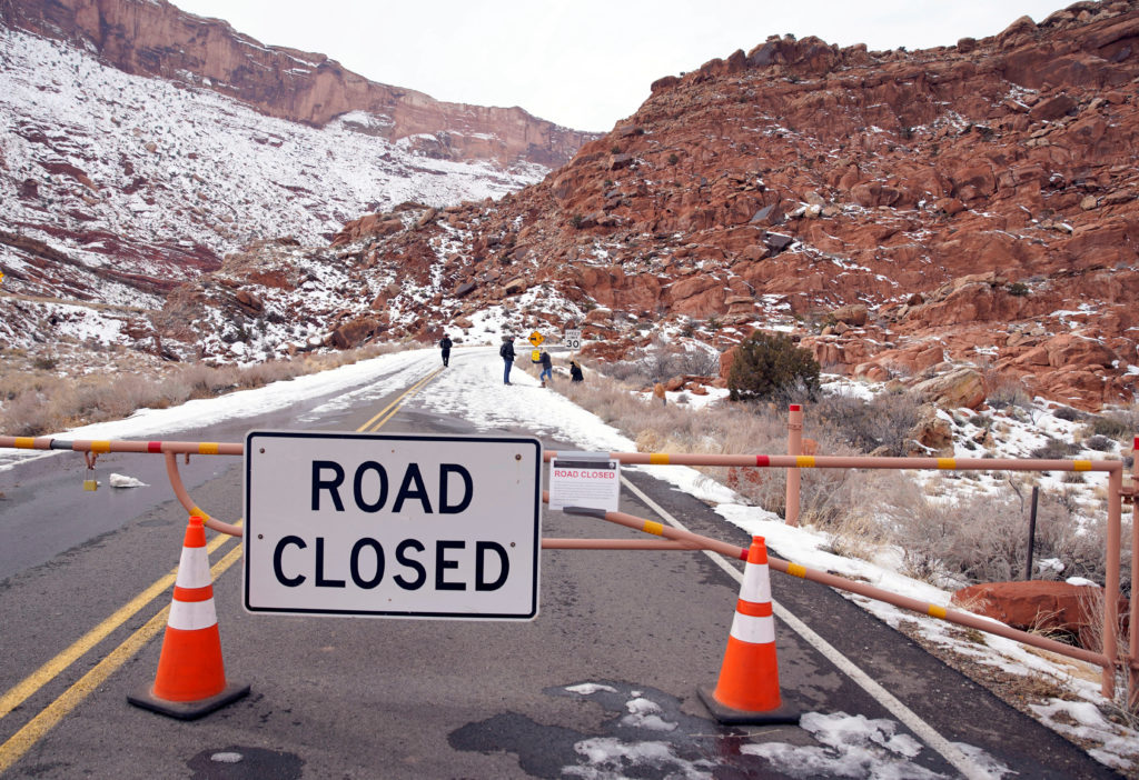 Hikers walk up the main road, which is closed because of the partial government shutdown, in Arches National Park, Utah, U.S., January 9, 2019. REUTERS/George Frey - RC1F4677E5C0