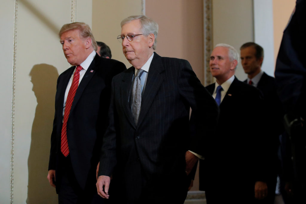 U.S. President Donald Trump departs with U.S. Senate Majority Leader Mitch McConnell and Vice President Mike Pence after a...