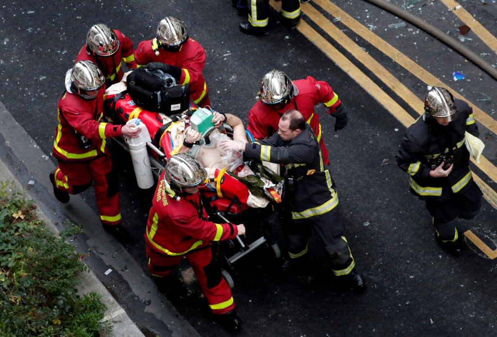 ATTENTION EDITORS - VISUAL COVERAGE OF SCENES OF INJURY OR DEATH Firemen wheel a stretcher carrying a man injured in an explosion in a bakery shop in the 9th District in Paris, France, January 12, 2019 Photo by Benoit Tessier/Reuters
