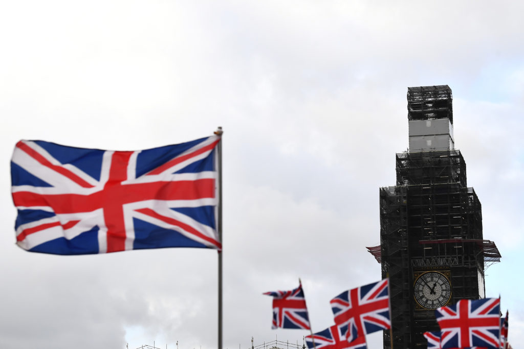 Union Jack flags fly around the Big Ben clock tower at the Houses of Parliament in London on January 14, 2019. Clodagh Kil...