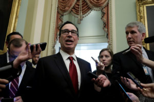 U.S. Treasury Secretary Steve Mnuchin speaks to Capitol Hill reporters after it was reported House Majority Leader Steny Hoyer (D-MD) would ask the Treasury Department to delay the lifting of sanctions on two companies tied to Russian oligarch Oleg Deripaska to give Congress time to review the decision in Washington. Yuri Gripas/Reuters