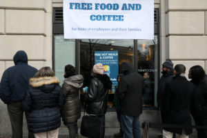 Federal workers left unpaid or furloughed by the extended partial government shutdown stand in line for fresh food and coffee at the World Central Kitchen, a volunteer emergency kitchen run by Chef Jose Andres, in Washington, D.C. on January 16, 2019. Jonathan Ernst/Reuters