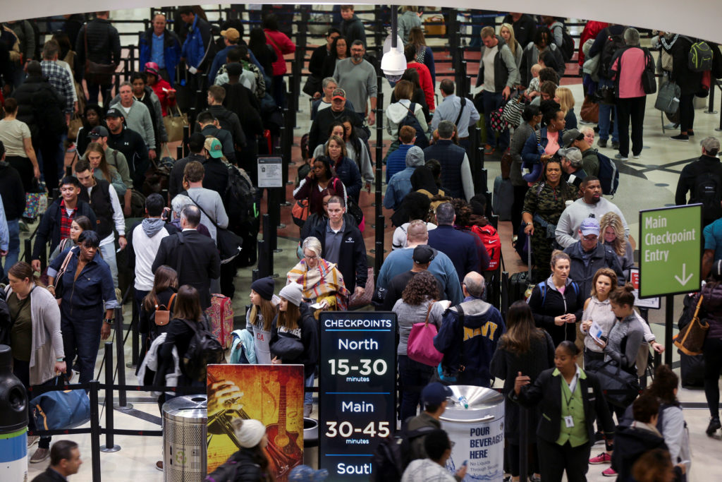 Long lines are seen at a Transportation Security Administration (TSA) security checkpoint at Hartsfield-Jackson Atlanta International Airport amid the partial federal government shutdown, in Atlanta, Georgia, U.S., January 18, 2019. REUTERS/Elijah Nouvelage - RC1F52AA9C60