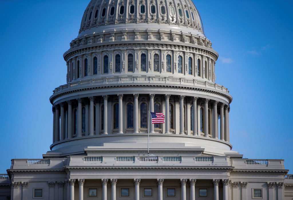An American flag flies at the U.S. Capitol in Washington, D.C. Photo by Al Drago/Reuters