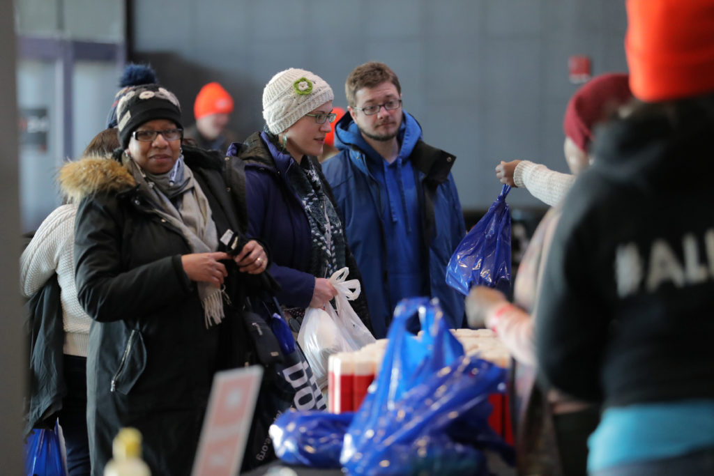 Government employees receive donations at a food distribution center for federal workers impacted by the government shutdown, at the Barclays Center in Brooklyn. Photo by Brendan McDermid/Reuters