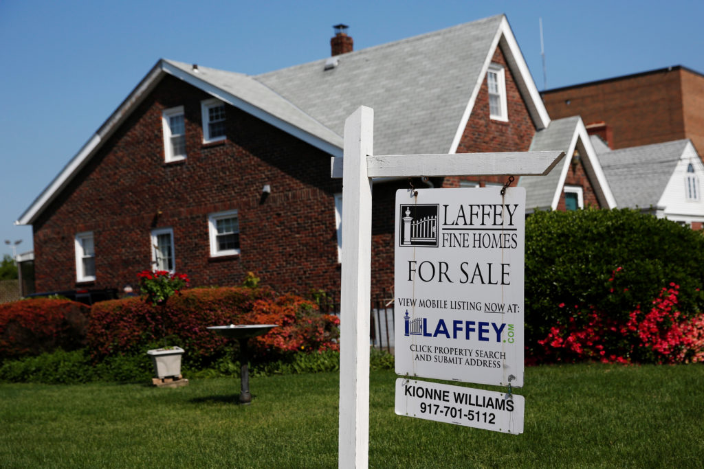 A 'for sale' is seen outside a single family house in Uniondale, New York. Photo by Shannon Stapleton