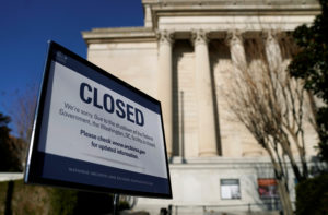 A sign declares the National Archive is closed due to a partial federal government shutdown in Washington, D.C. Photo by Joshua Roberts/Reuters