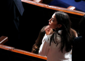 Rep. Alexandria Ocasio-Cortez, D-New York, stands inside the House Chamber as the U.S. House of Representatives meets for the start of the 116th Congress on Capitol Hill. Leah Millis/Reuters