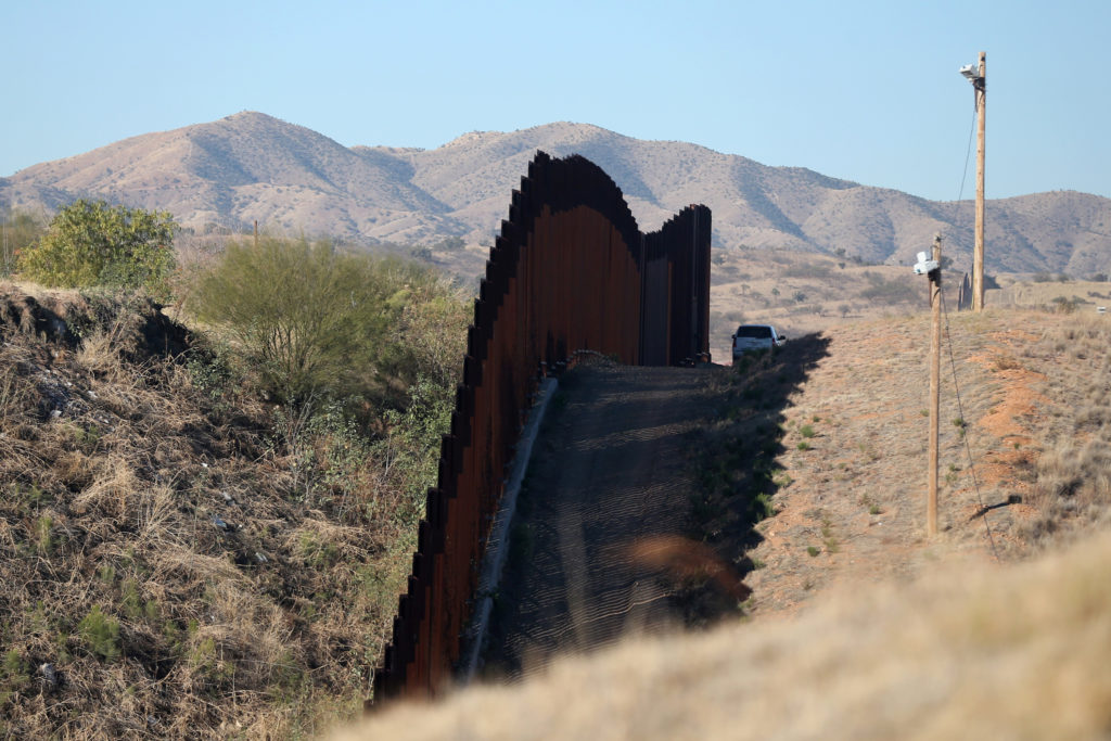 A U.S. border patrol agent patrols the U.S. border with Mexico in Nogales, Arizona, U.S., January 31, 2017. Picture taken ...