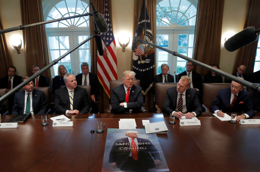 U.S. President Donald Trump attends a Cabinet meeting on day 12 of …