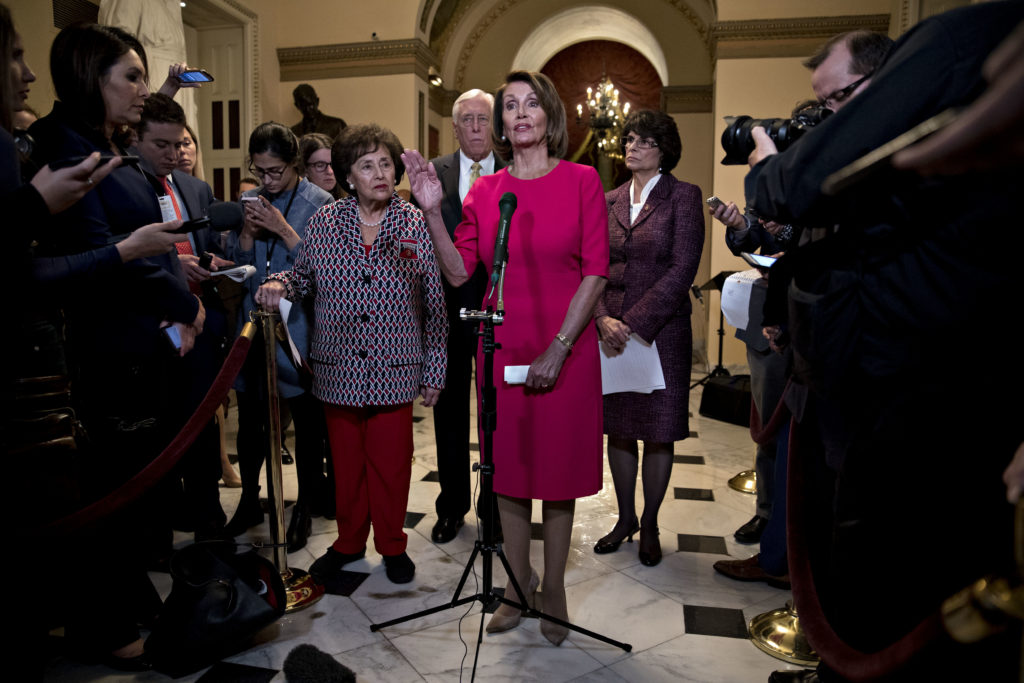 U.S. House Speaker Nancy Pelosi, a Democrat from California, center, speaks during a news conference before a vote on endi...
