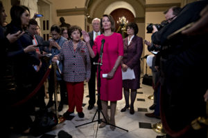 """U.S. House Speaker Nancy Pelosi, a Democrat from California, center, speaks during a news conference before a vote on ending the government shutdown at the U.S. Capitol in Washington, D.C., U.S., on Thursday, Jan. 3, 2019. Pelosi was elected speaker of the House of Representatives in a triumphant return to the post Thursday, pledging to reach across the aisle to Republicans and make transparency the """"order of the day"""" as Democrats took power. Photographer: Andrew Harrer/Bloomberg via Getty Images"""