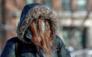 A student is dressed for subzero temperatures while walking to class at the University of Minnesota in Minneapolis, Minnesota, U.S., January 29, 2019. Photo by REUTERS/Eric Miller