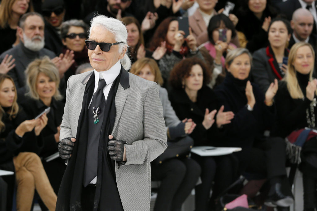 German designer Karl Lagerfeld appears at the end of his Haute Couture Spring Summer 2015 fashion show for French fashion ...