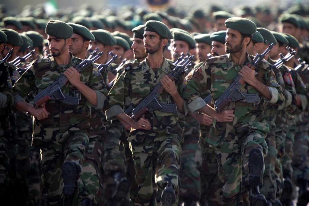 Members of Iran's Revolutionary Guards march during a military parade to commemorate the 1980-88 Iran-Iraq war in Tehran. ...