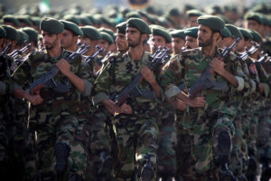 Members of Iran's Revolutionary Guards march during a military parade to commemorate the 1980-88 Iran-Iraq war in Tehran. Photo by Morteza Nikoubazl/Reuters